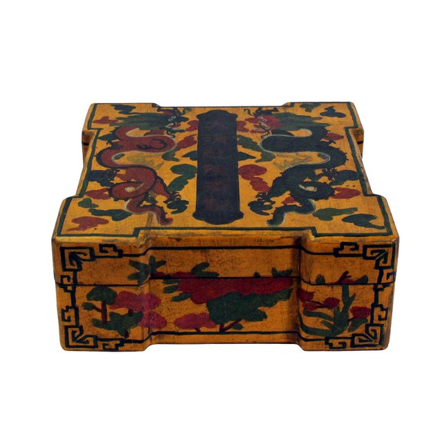 This is a handmade Chinese accent decorative box made of wood and finished with a distressed vintage yellow base color....