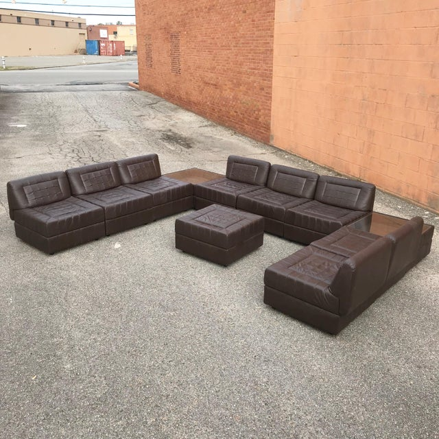Exceptional 11 piece 1970's modular brown leather sectional sofa made in Brazil and designed by Percival Lafer. Pieces...