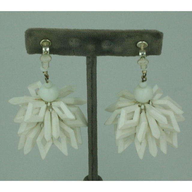 """Miriam Haskell, white abstract floriform , white glass and lucite earrings . 3"""" Due to the unique nature of this product,..."""