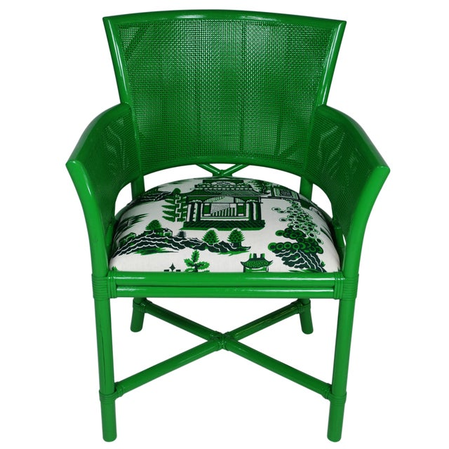 Set of four Ficks Reed armchairs that are newly lacquered in a rich green. The sleek rattan frames have caned backs and...
