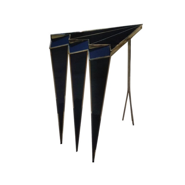 The Susan side table is a made to order side table featuring our signature faceted design. This triangular table is made...