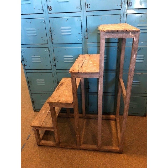 Primitive French ladder with hints of modern sculptural design via a series of rectangles. Pegged nails. Well-worn farm-...