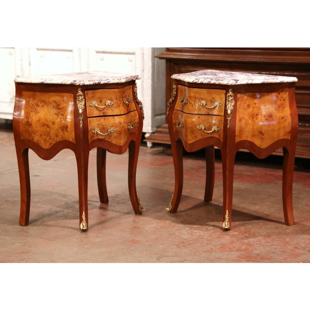 These elegant bedside tables were created in France, circa 1980. Bombe in shape on all three sides, the fruitwood petite...