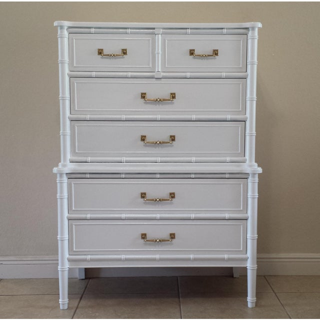 Add a touch of a Regency-inspired glam to your decor with this 1960s, five-dovetailed drawers chest, white lacquered.