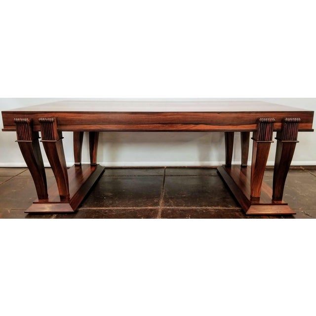 High-gloss finish Bolivian Rosewood ( Machearium Villosum ) rectangular coffee table in a Traditional design with eight...