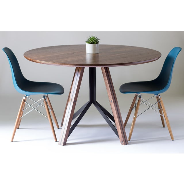 Made from solid walnut and welded steel, the Trestle takes inspiration from classic bridge construction and the Iconic...