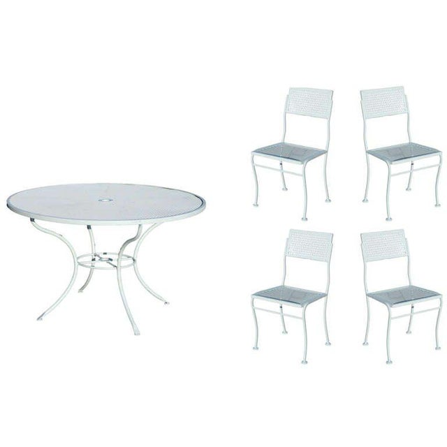 Outdoor steel mesh table and chairs set with one table and four chairs by the Woodard Company. The set has been repainted...