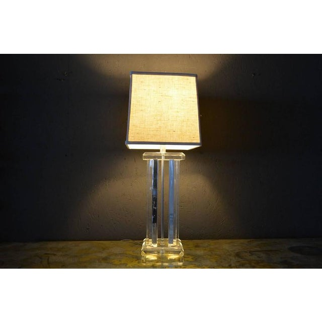 For your consideration a single Lucite table lamp, USA, circa 1960s. Unmarked, no information on the maker. Lampshade not...