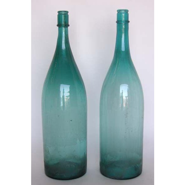 Pair of very large glass sake bottles. Great aqua color. Can be sold separately, $570 each.