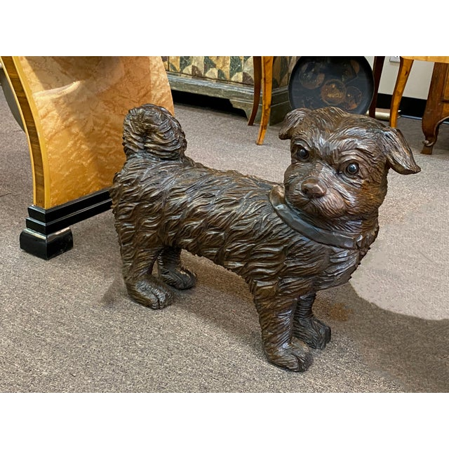 A 19th century wonderfully carved standing dog with glass eyes, from France.