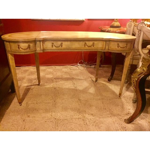 Beautiful French writing desk. Made by Maitland-Smith in cream leather.