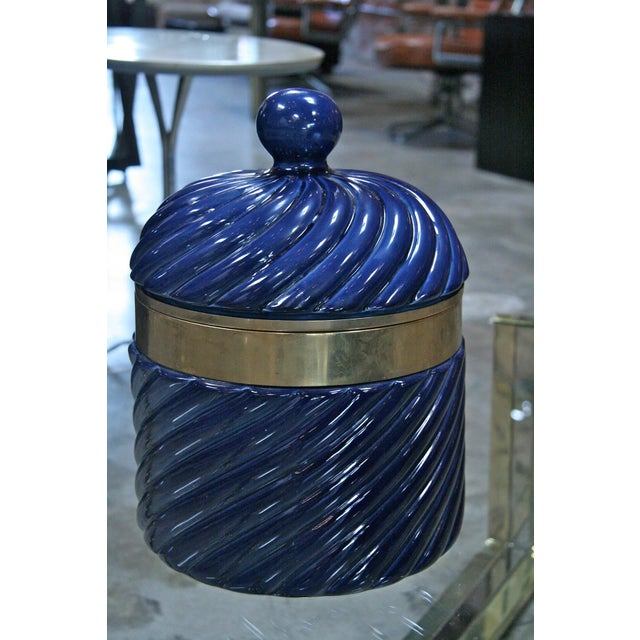 How chic... an ice bucket in blue ceramic and brass by Tommaso Barbi.