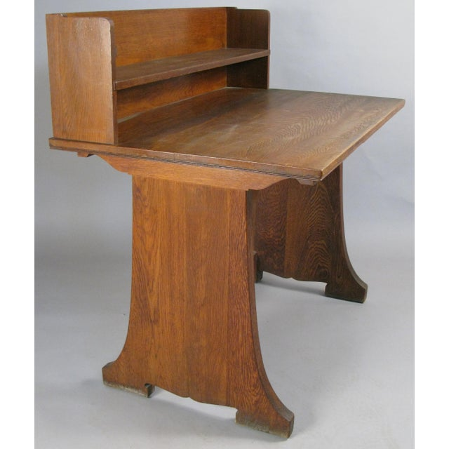 A very handsome antique oak writing desk originally from the Harvard Divinity School. With privacy riser in the back, and...