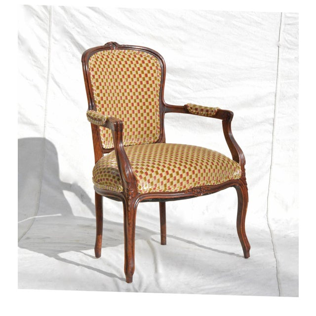 A vintage 1960s Louis XV style fauteuil having open and down swept arms and elegant cabriole legs. The single chair is...