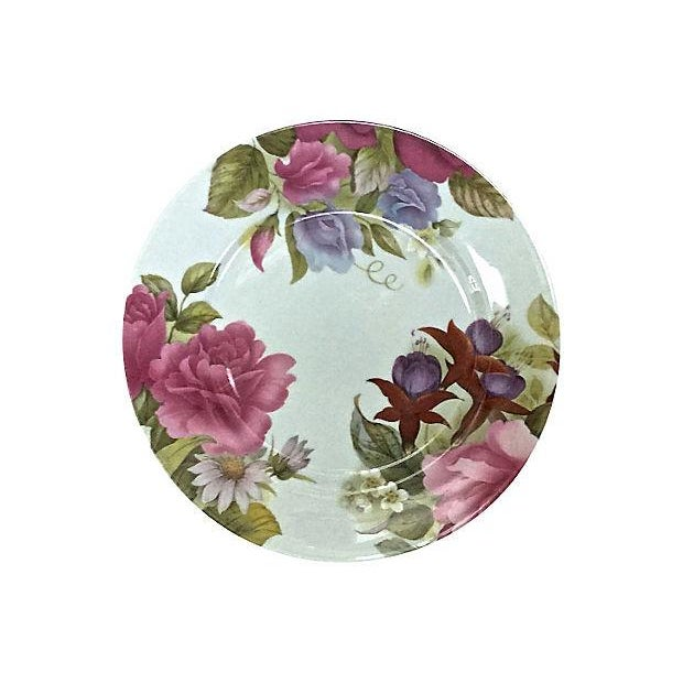 Set of six Vintage; 1980s, French, Limoges, porcelain, floral plates from the Joan Rivers Estate. Depicts three different...