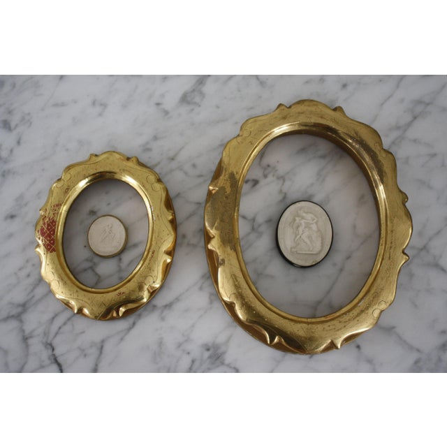 Pair of deep set, decorative, lemon gilt oval frames that would be perfect for displaying intaglios. CONDITION: Good...
