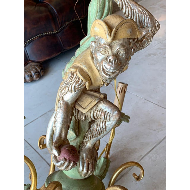 Delightful, hand carved chandelier featuring a monkey dressed as a pirate. Six-light Rococo revival chandelier is ornate...