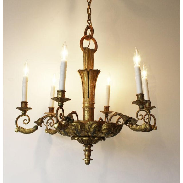 A fantastic 19th Century Italian giltwood 6 light chandelier. Condition: Excellent showroom condition with new wiring....