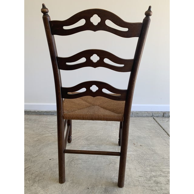 Early 20th Century French Country Carved Pierced Ladder Back Chair With Rush Seat For Sale - Image 4 of 7