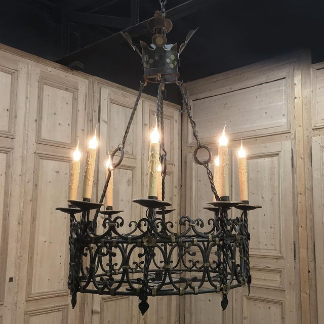 Antique Country French Wrought Iron Chandelier features amazing detail, and has been fitted with standard electrification...