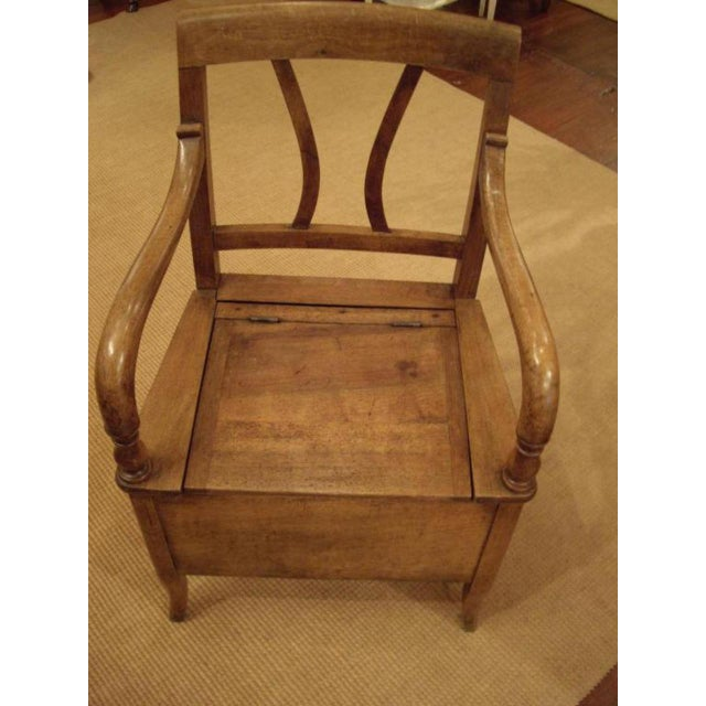Very nice walnut French 19th century potty arm chair. Top and side open up. Circa 1830.