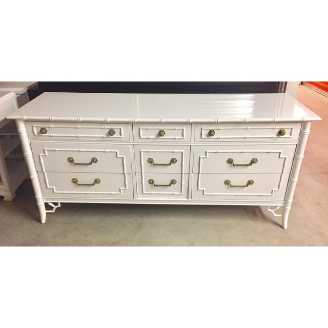 Offered is a vintage newly lacquered in Benjamin Moore Simply White Thomasville Allegro long dresser. This piece features...