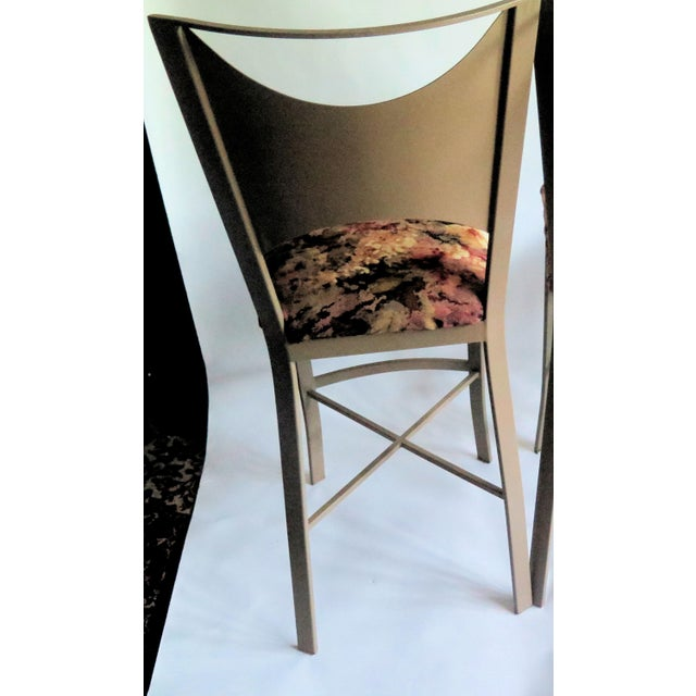 "4 newly refinished and reupholstered slightly bowed back ""X"" support flat iron bar stools They are painted in an appealing..."