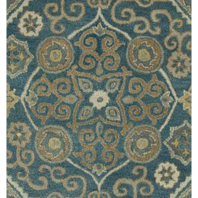 With a regal design, this rug will make an elegant statement piece in a traditional or transitional home. Ethically...