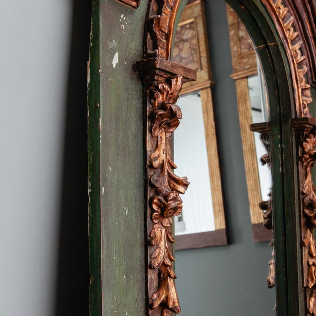 Circa 1880s French mirror has a green painted and carved frame with extensive gilded detail. Dealer Reference Number: 3047