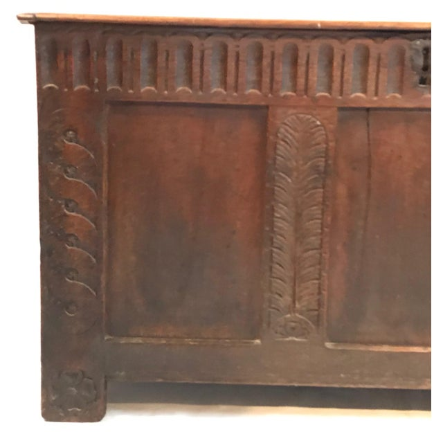 18th century oak plank coffer with the hinged top above a three-paneled front with carved decoration, wonderfully carved...