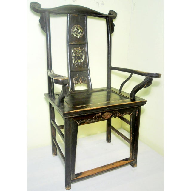 """This style of chair is known as """"official's hat chair"""" because the projections over the rear stiles resemble the knobs on..."""