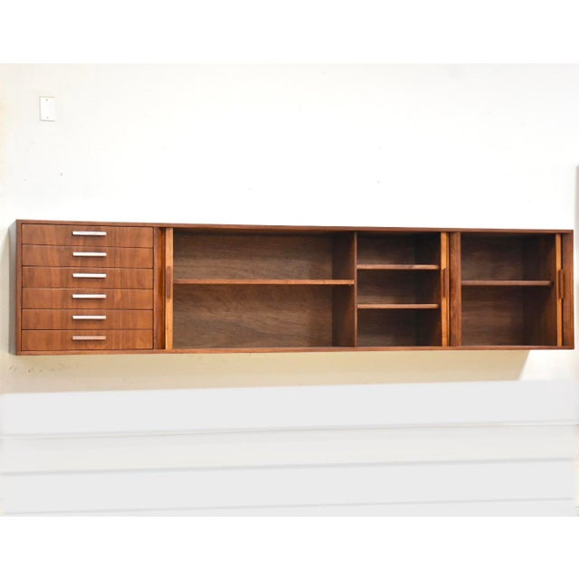 """A phenomenal 108"""" wide mid century modern walnut floating credenza or tv console with tambour doors by Furnette..."""