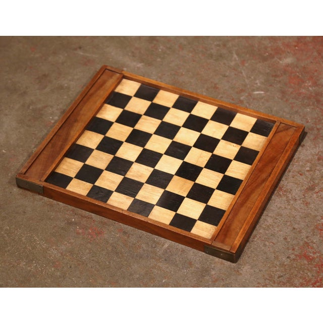 Decorate a card table with this antique checkers game; created in France circa 1890 and made of walnut, the board game is...