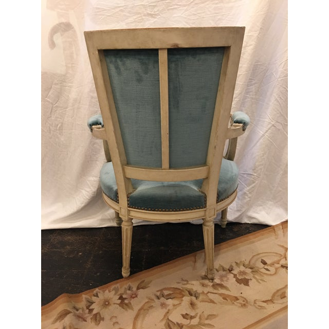 These lovely Louis XI Style arm chairs have fantastic light blue velvet. Dating to the 1900's, the paint is moderately...