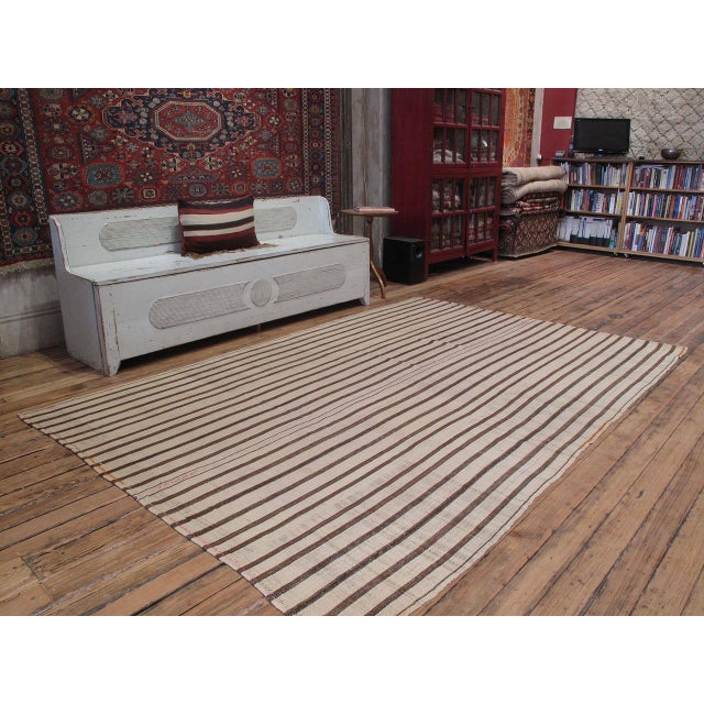 """A simple old tribal flat-weave from Southeastern Turkey, woven in """"jajim"""" technique with alternating bands of wool in..."""
