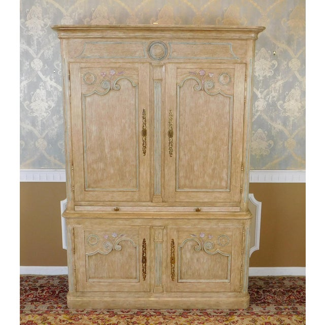 Description: This is a large paint decorated armoire ~ bar cabinet made by Baker Furniture, unmarked, c1980s. Cabinet is...