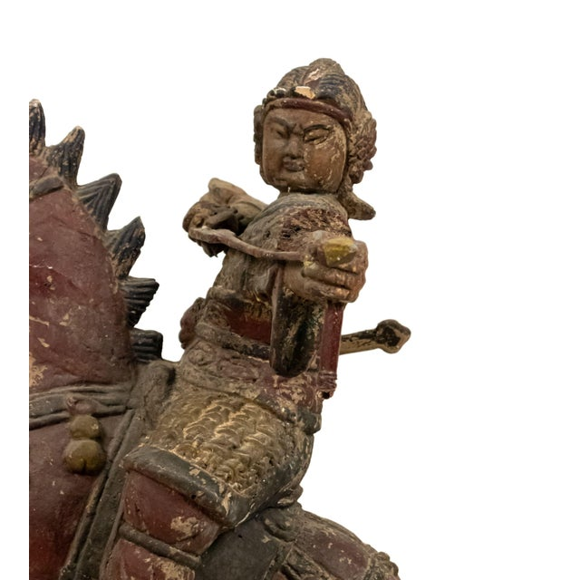 Asian Mongolian carved wooden figure of a warrior on a horse preparing to shoot (paint loss and small chips) No Bow