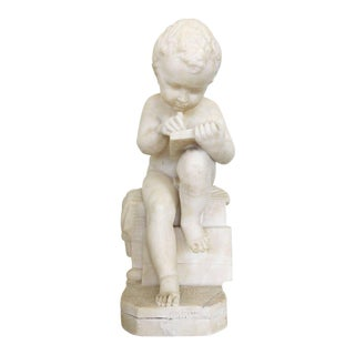 Carved White Marble Sculpture of a Child Writing For Sale