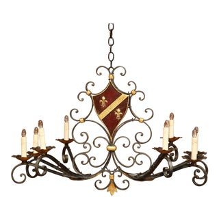 Early 20th Century French Eight-Light Iron Chandelier With Center Painted Shield For Sale