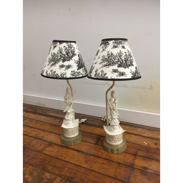 Porcelain lamps on metal bases. Paired with vintage black and white shades (clip on).