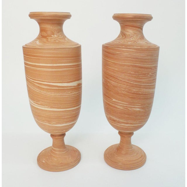 A pair of English marbleized pottery vases of classical form. The Brian Rose model. Torquay factory. Impressed mark, circa...