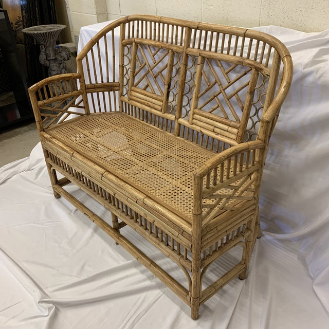 Beautiful vintage bamboo bench in near perfect condition. Bamboo frame and cane seat. Cane is solid and strong. No holes....