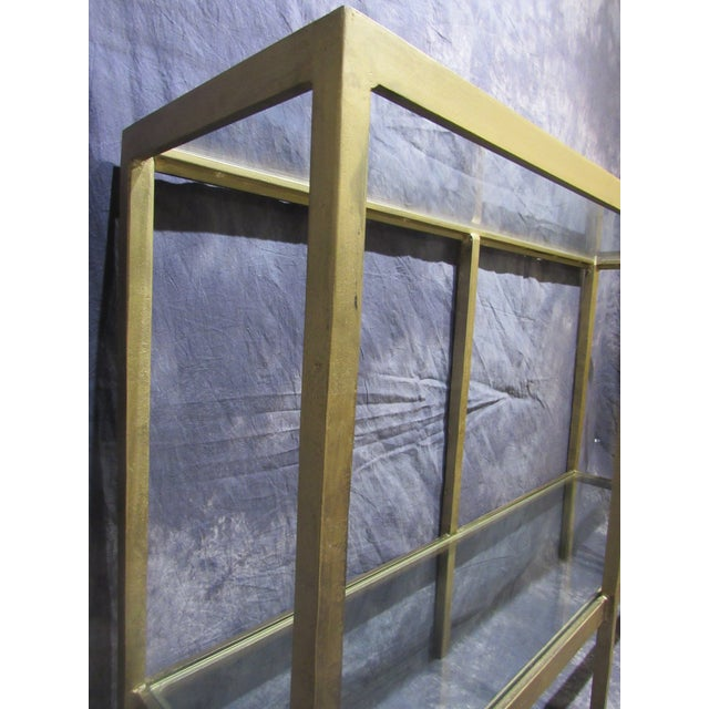 The versatile glass console table has a chic and modern style. This piece is very heavy and Finished in an elegant gold...