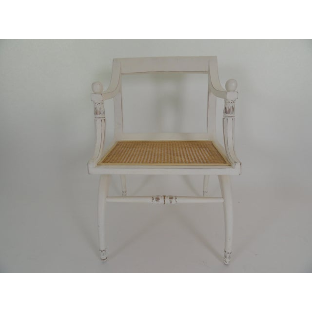 English Regency style cane chair with newly caned seat with white, lightly distressed finish.