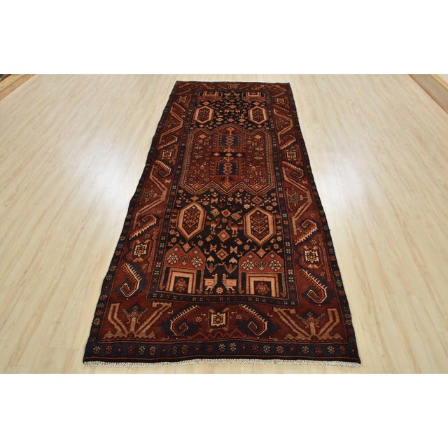 This is an authentic vintage tribal Persian Koliai rug hand-knotted in Persia with an all wool pile with abrash on a...