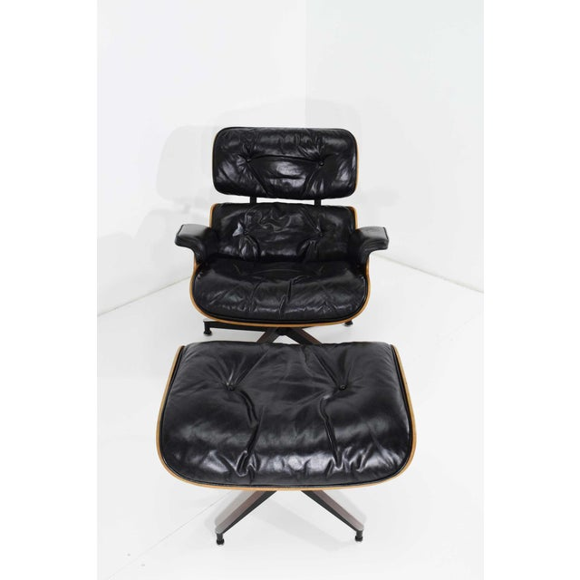 Charles and Ray Eames lounge chair with ottoman by Herman Miller, early 1960s production. The chair is down filled, has...