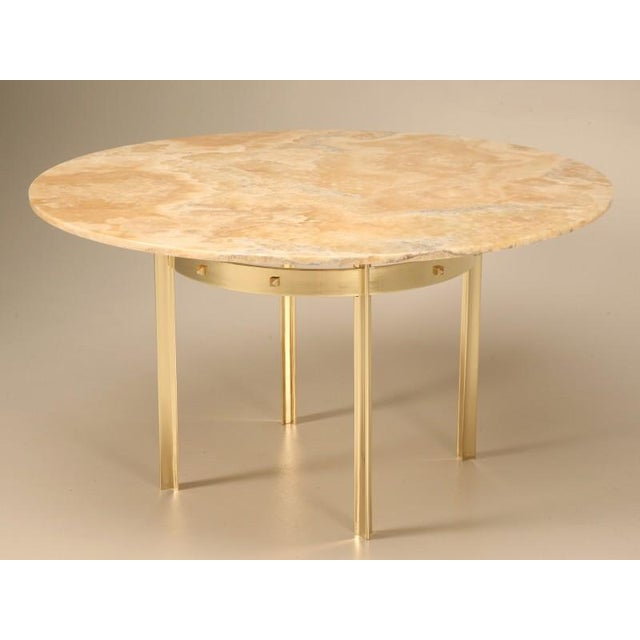 A sensational mid-century French design, this modern reproduction of a solid brass dining table with a stunning piece of...