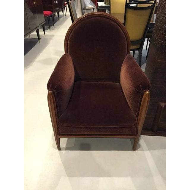 This pair of French art deco club chairs dates back to the 1930s. The carved front legs extend up to support the arms and...
