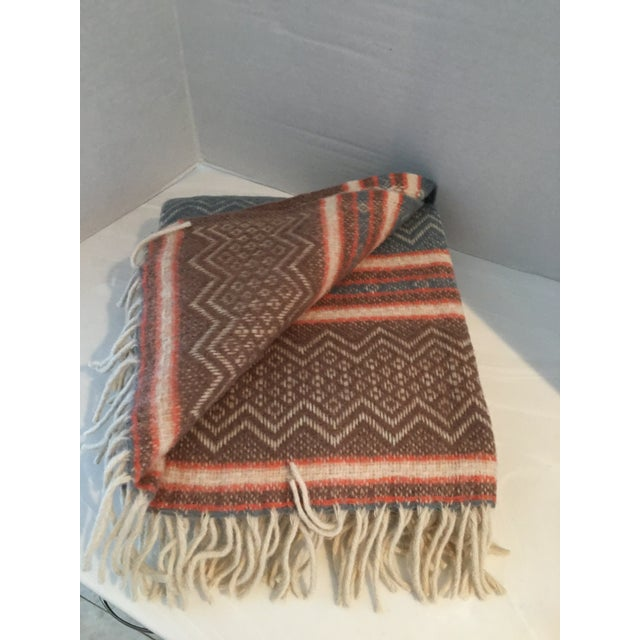 """New with tags Faribo Mesa wool blanket/throw. 100% wool. Measures 50"""" x 60"""". Made in USA !"""