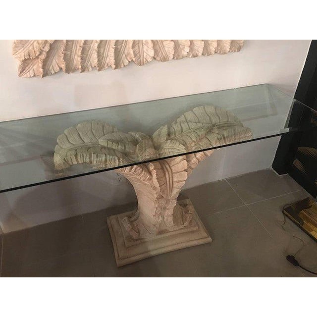 Lovely vintage console table and mirror set. Tropical leaves, palm tree frond, leaves, Leaf with faux bamboo border on...